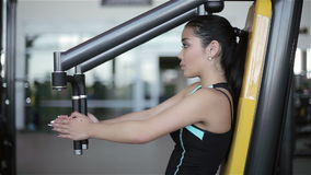 Young attractive asian woman in the gym. Footage by slider (dolly) left to right.  stock video