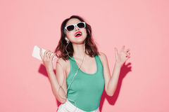 Young attractive asian woman with professional makeup singing an Royalty Free Stock Photos