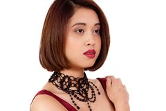 Young attractive asian woman with red lips and jewelry  Royalty Free Stock Photos