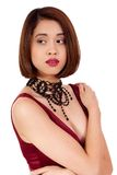 Young attractive asian woman with red lips and jewelry isolated Royalty Free Stock Photo