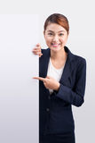 Young attractive asian woman showing a white board Stock Images