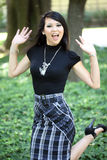 Young attractive asian woman in skirt and top Royalty Free Stock Photography