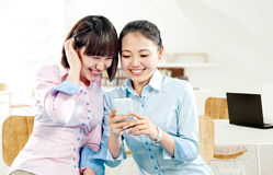 Young attractive asian women to see a smart phone Royalty Free Stock Photo