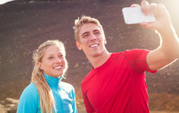 Young attractive athletic couple taking photo Royalty Free Stock Image