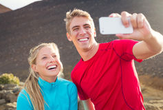 Young attractive athletic couple taking photo Royalty Free Stock Photo