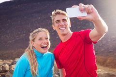 Young attractive athletic couple taking photo of themselves Stock Photo