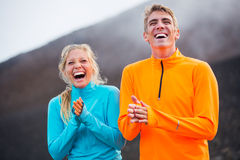 Young attractive athletic couple, wearing sporty cloths Stock Photography