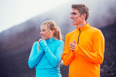Young attractive athletic couple, wearing sporty cloths on trail Royalty Free Stock Photo