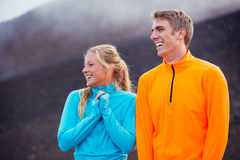 Young attractive athletic couple, wearing sporty cloths on trail Royalty Free Stock Photography