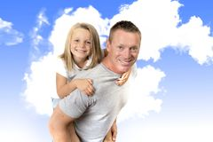 Young attractive and athletic father carrying on his back young Stock Image