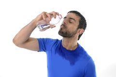 Young attractive and athletic sport man drinking water Royalty Free Stock Images