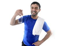 Young attractive and athletic sport man drinking water Stock Photos