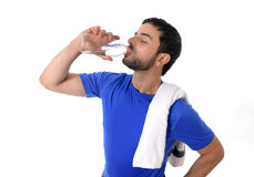 Young attractive and athletic sport man drinking water Royalty Free Stock Photos