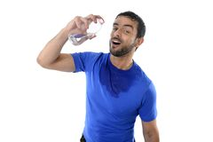 Young attractive and athletic sport man drinking water Stock Images