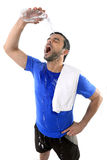Young attractive and athletic sport man exhausted pouring water on his face Stock Image