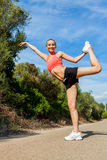 Young attractive athletic woman stretching fitness Royalty Free Stock Photo