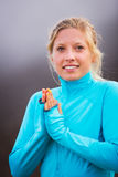 Young attractive athletic woman, wearing sporty cloths Stock Images
