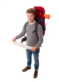 Young attractive  backpacker tourist looking map carrying big ba Royalty Free Stock Image