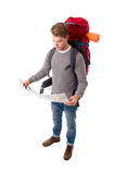 Young attractive backpacker tourist looking map carrying big backpack lugagge stock image