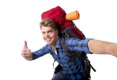 Young attractive backpacker tourist taking selfie photo carrying backpack ready for travel Stock Photos