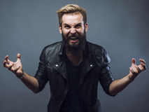 Young attractive bearded hipster man gesturing Royalty Free Stock Photography