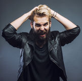 Young attractive bearded hipster man gesturing emotional screaming in studio Royalty Free Stock Image