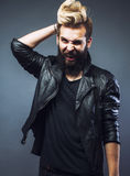 Young attractive bearded hipster man gesturing emotional screaming in studio sucsess Royalty Free Stock Photography