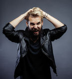 Young attractive bearded hipster man gesturing Stock Photo