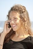 Young attractive beauty making a phonecall. At the beach Stock Images