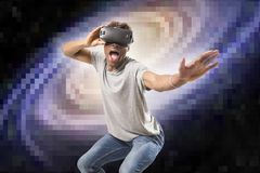 Young attractive black afro American man using vr virtual reality 3D goggles playing space travel videogame with pixelated compute. R planet and solar system stock photography