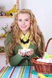 Young attractive blond with easter eggs in basket Royalty Free Stock Photos