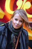 Young attractive blond girl. On a bright  background Royalty Free Stock Photo