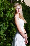 Young attractive blond girl posing outdoors Stock Images