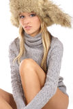 Young and attractive blond wearing a winter hat Stock Images