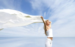 Young and attractive blond with a white canvas Royalty Free Stock Image