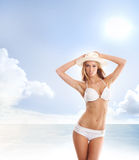 A young and attractive blond with a white hat Stock Photo