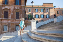 Young attractive blond woman barefoot сlimbs the stairs in spanish steps in Rome. ITALY Stock Images