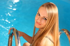 Young attractive blond woman at a pool Royalty Free Stock Image