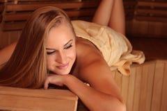 Woman in sauna royalty free stock image