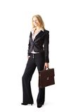 Young attractive blonde business woman. A young attractive blonde business woman carrying her documant case, isolated on a white background Royalty Free Stock Images