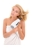 Young attractive blonde drying her hair with hairdryer Royalty Free Stock Image
