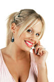 Young attractive blonde female making a phone call. Isolated over white Royalty Free Stock Photos