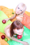 Young attractive blonde with fruits lying Stock Photos