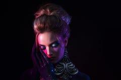 Young attractive blonde girl in bright art-makeup, in purple tones. Sleeping Stock Images