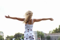Young Attractive Blonde Girl Spreading Her Arms.  Royalty Free Stock Photos