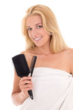 Young attractive blonde with hairbrushes on white background Royalty Free Stock Images