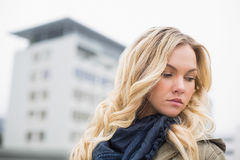 Young attractive blonde posing outdoors Stock Image