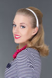 Young attractive blondie pinup girl in striped dress Stock Image