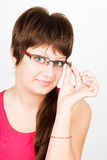 Young attractive blue-eyed girl in glasses Royalty Free Stock Images