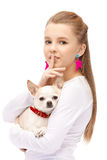 Young attractive blue eyes girl with dog chihuahua Stock Photography